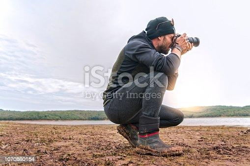 camping,man,lake,freedom,lifestyle,photographer,camping photographer,sunlight,mud,boot
