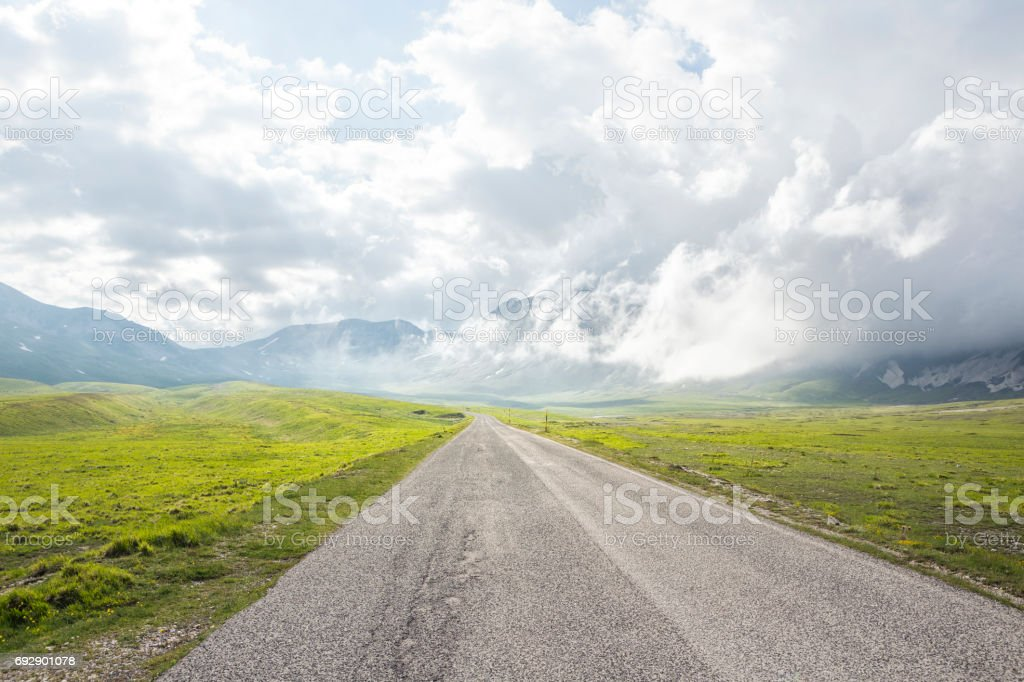 Campo Imperatore with country road, Abruzzi Italy stock photo