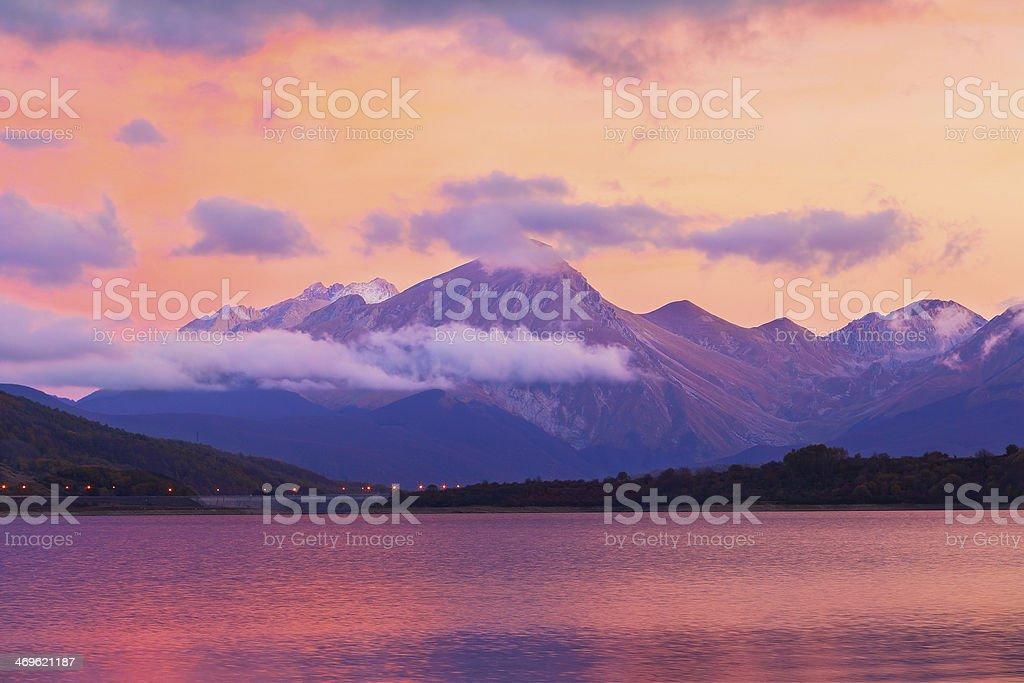 campotosto lake sunset stock photo