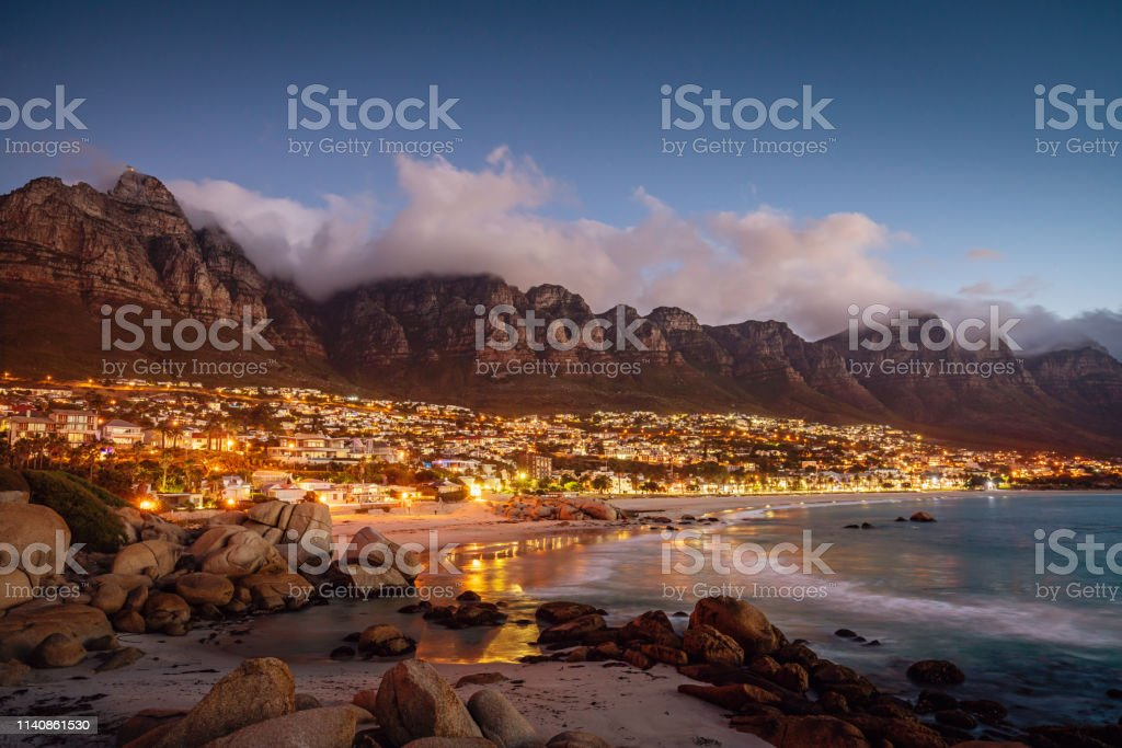 Camps Bay Atmospheric Twilight Cape Town South Africa Beautiful illuminated Camps Bay, Scenic view after sunset with beautiful cloudscape. Camps Bay, famous suburb of the city of Cape Town with white sandy beaches underneath the Table Mountain. Cape Town, South Africa Africa Stock Photo