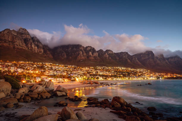 camps bay atmospheric twilight cape town south africa - table mountain national park stock pictures, royalty-free photos & images