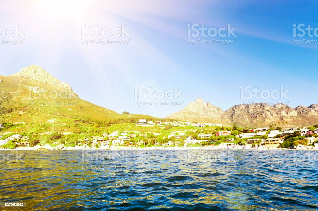 Camps Bay, Cape Town, seen from Table Bay in sunshine stock photo