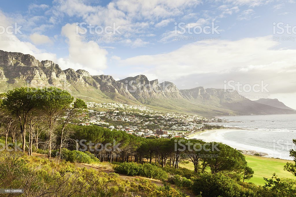 """Camps Bay Cape Town Suburb South Africa """"View over Camps Bay, a suburb of the city of Cape Town with beautiful beaches underneath famous Table Mountain. Cape Town, South Africa."""" Africa Stock Photo"""