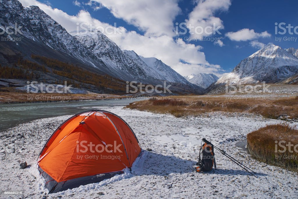 Campsite and Tent with backpack in the Mountains stock photo