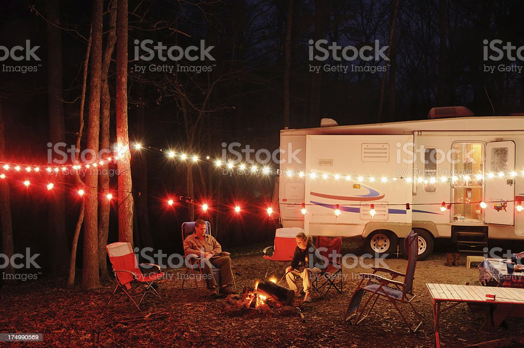 Christmas Lights For Camping.Rv Campsite At Night With Christmas Lights Stock Photo