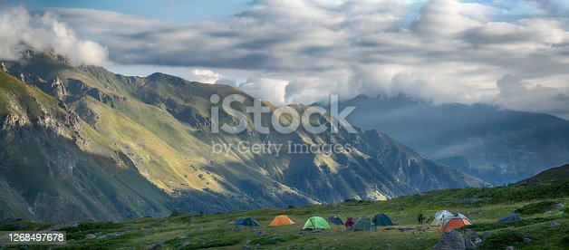 Campsite with group of camping tents. Sunrise in mountains