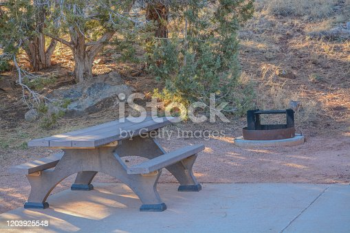 Campsite with a fire pit and picnic table at Fool Hollow Lake in Show Low, Navajo County, Apache Sitgreaves National Forest, Arizona USA