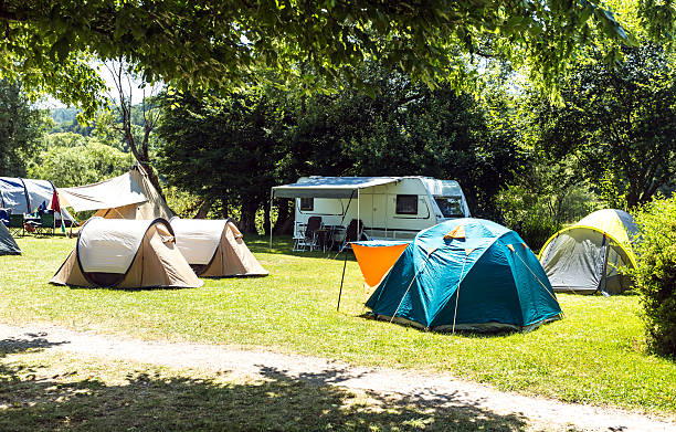 Campsite with tents Campsite with tents trailer park stock pictures, royalty-free photos & images