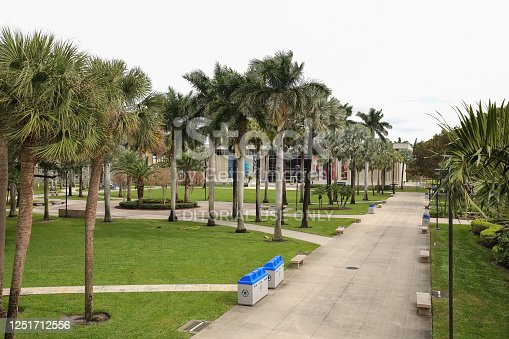 Boca Raton, Florida, USA - December 23, 2019:  Florida Atlantic University (FAU) campus walkway leading to the Kenneth R. Williams Administration Building.
