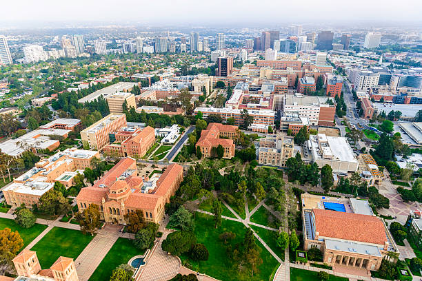 UCLA campus in Los Angeles, California - aerial view aerial view of campus of University of California in Los Angeles, with smoggy cityscape of  Los Angeles, California in the background ucla stock pictures, royalty-free photos & images