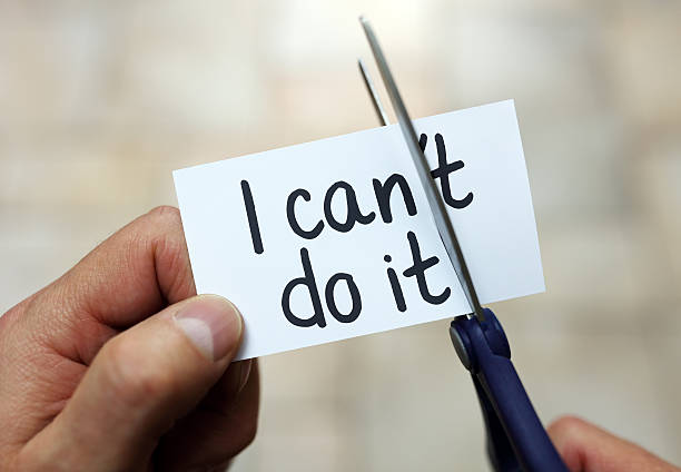 I can do it Man using scissors to remove the word can't to read I can do it concept for self belief, positive attitude and  motivation positive emotion stock pictures, royalty-free photos & images