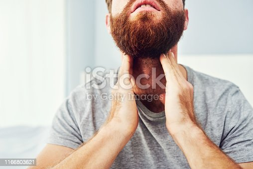 Cropped shot of an unrecognizable man suffering with a sore throat