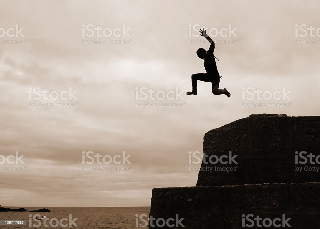 I can fly! Silhouette of Boy Cliff Diving royalty-free stock photo