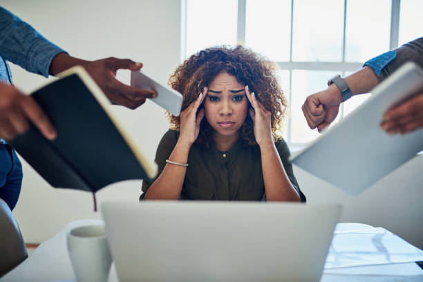Can I get a moment to breathe? Shot of a stressed out young woman working in a demanding career mental burnout stock pictures, royalty-free photos & images