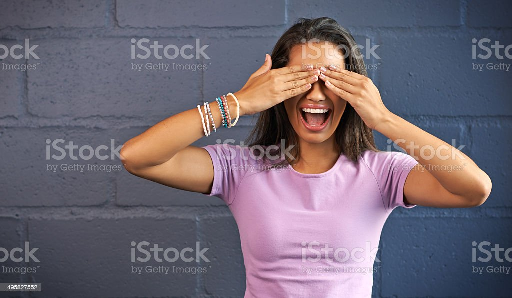 Can I open my eyes now? stock photo