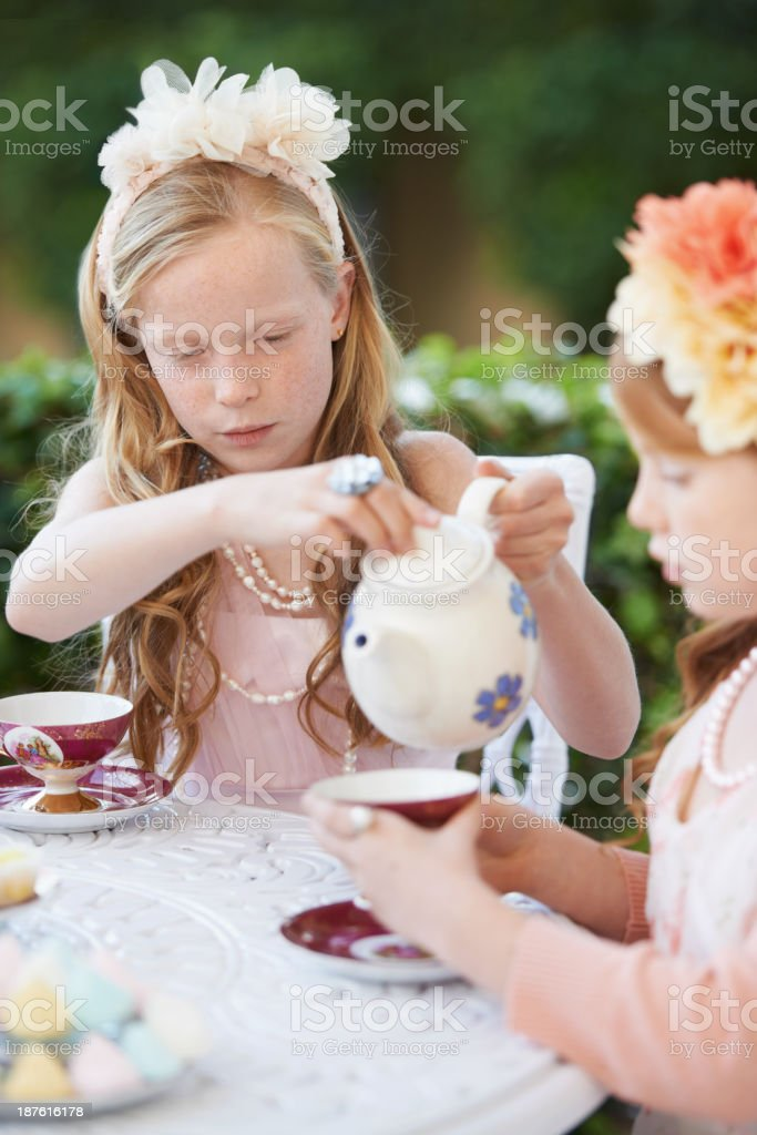 Can I pour you some more? royalty-free stock photo