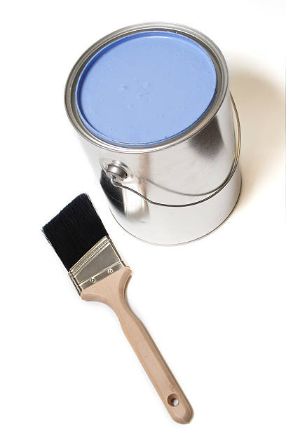 can of blue paint and brush isolated on white stock photo