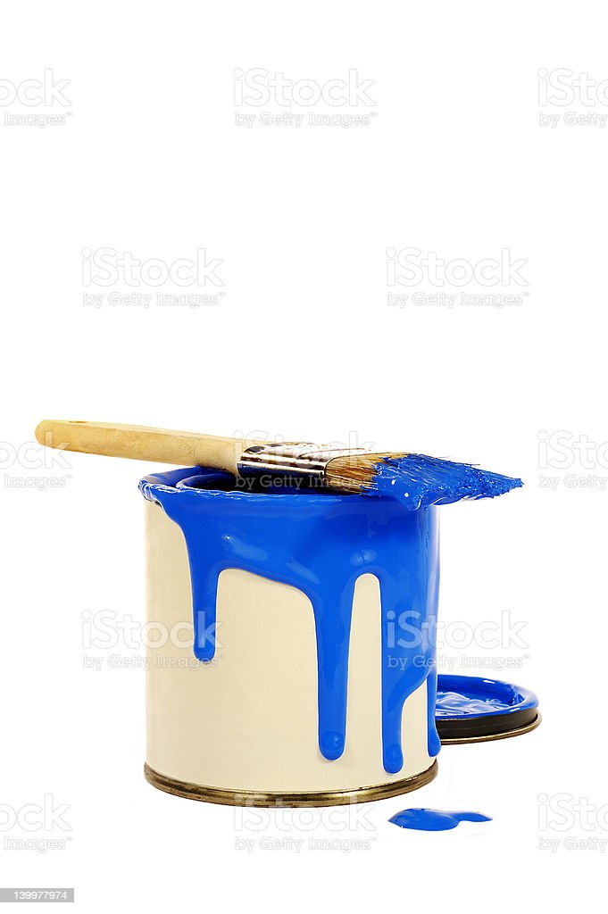 can of blue paint and brush stock photo