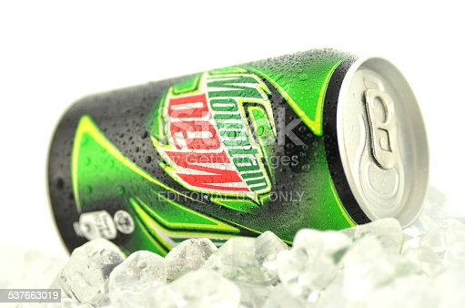 Kwidzyn, Poland - March 15, 2014: Can of Mountain Dew drink isolated on white. Mountain Dew citrus-flavored soft drink produced by PepsiCo. Mountain Dew was introduced in 1940