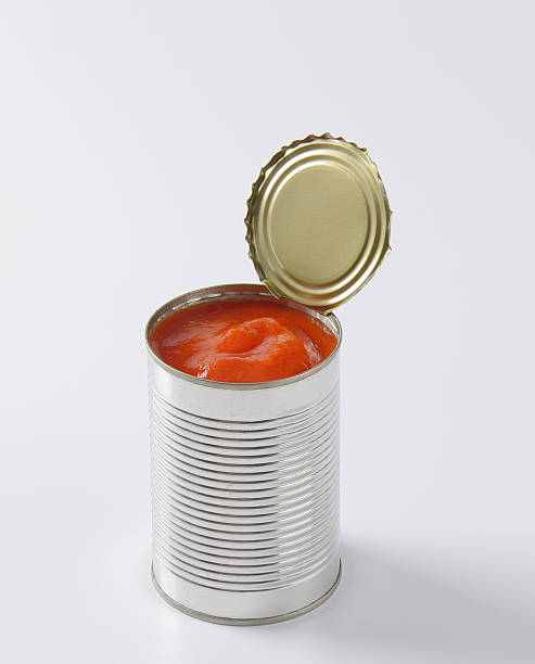 can of peeled tomatoes - tomato can stock photos and pictures