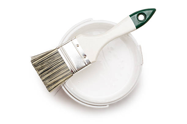 Can of white paint with brush stock photo