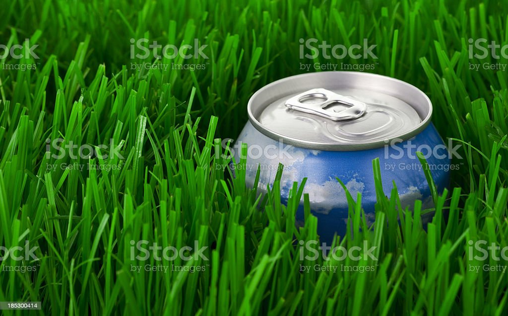 Can thrown in the grass stock photo