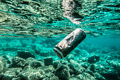 The can floats underwater in the crystal clear waters of the Adriatic Sea