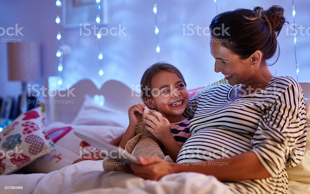Can we read another one, Mom stock photo