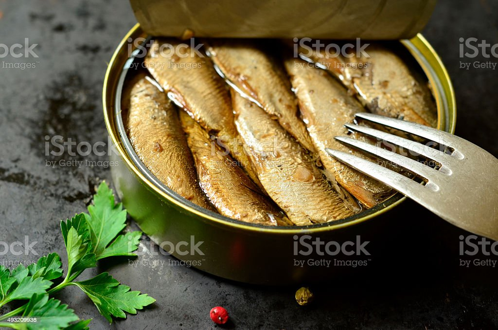 Can with smoked Baltic sprats. stock photo