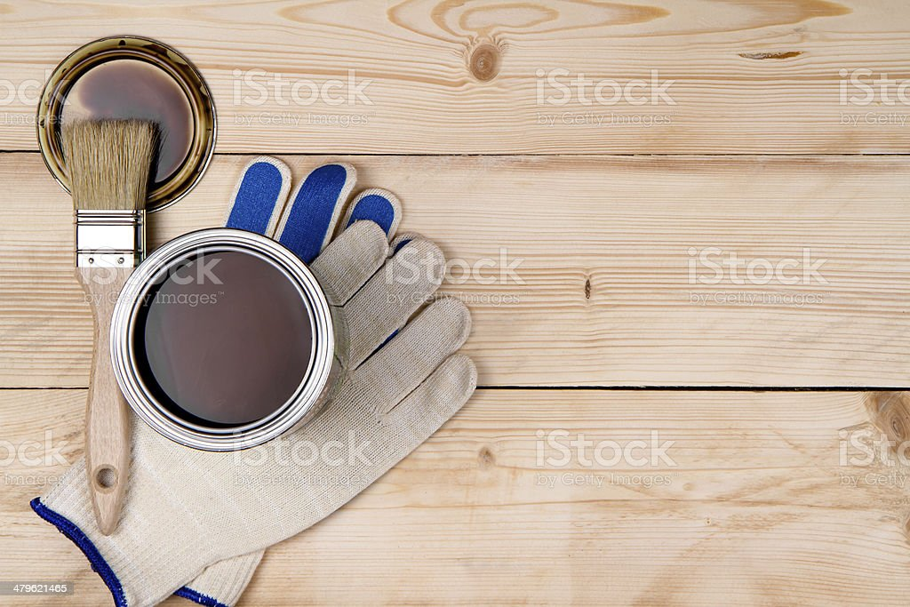 Can, working gloves and paint brush stock photo