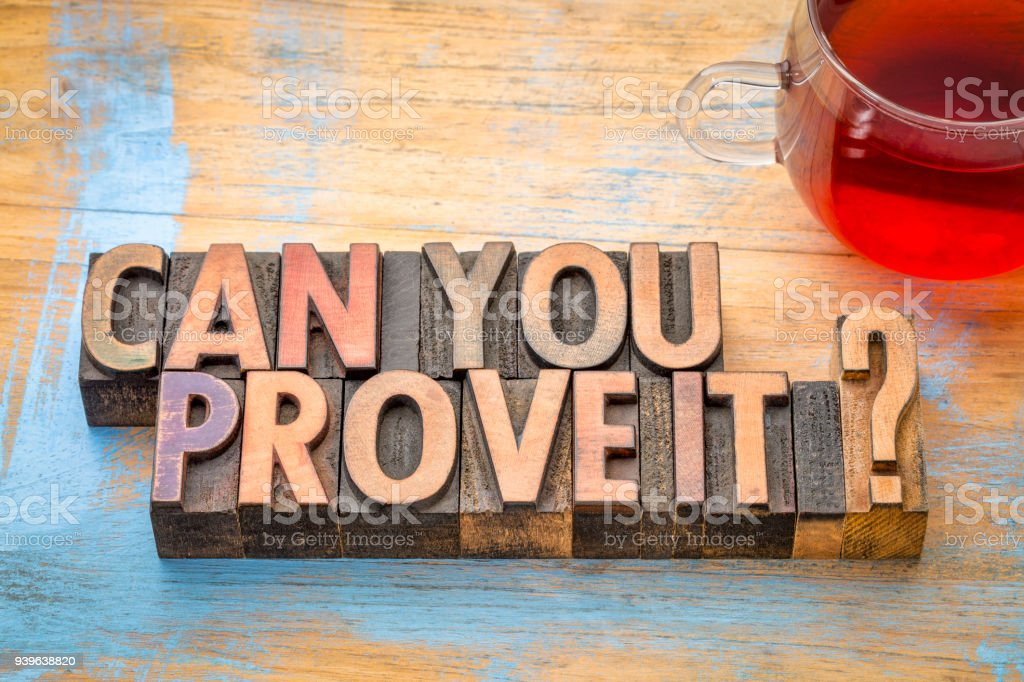 Can you prove it? Word abstract in wood type. stock photo