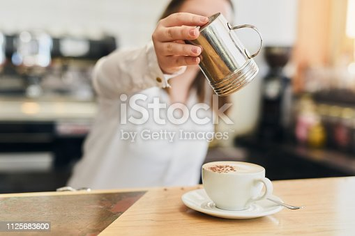 Shot of a young woman in a coffee shop