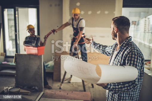 istock Can you stop working, I can't concentrate on these blueprints! 1039513126