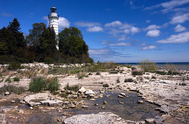 Cana Island Lighthouse during Summer in Door County Wisconsin stock photo