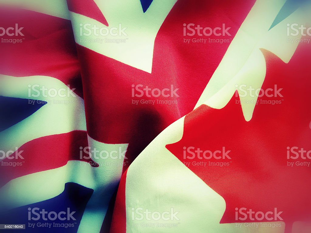Canada and Great Britain flags stock photo