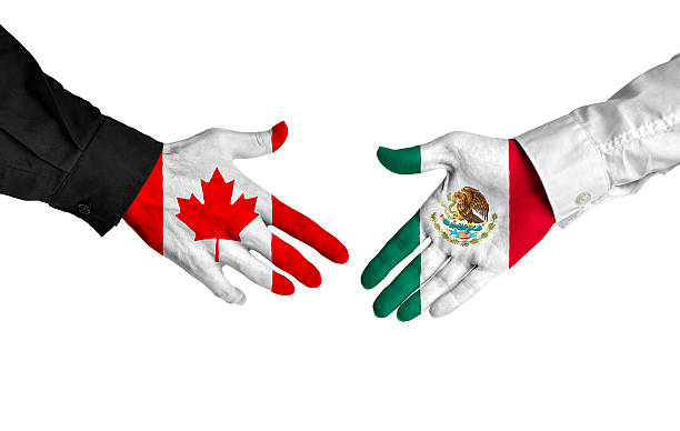 Canada and Mexico leaders shaking hands on a deal agreement stock photo