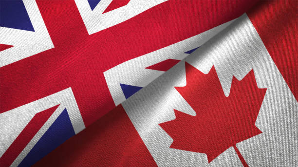 Canada and United Kingdom two flags together realations textile cloth fabric texture stock photo