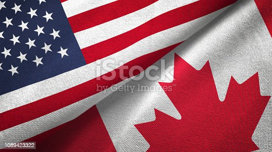 Canada and United States flags together realtions textile cloth fabric texture