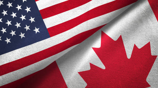 Canada and United States two flags together realations textile cloth fabric texture Canada and United States flags together realtions textile cloth fabric texture canada stock pictures, royalty-free photos & images