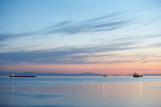 Canada, British Columbia, Vancouver, ships in English Bay at dusk stock photo