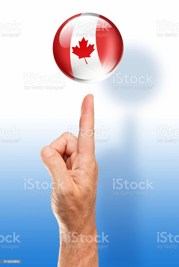 Canada button canadian flag pointing with human hand stock photo