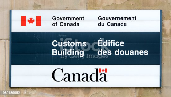 A Customs Building sign on a Government of Canada building. Closeup view.