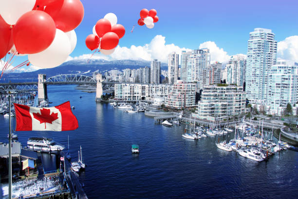 Canada day Balloons and flag. Canada day July 1. Canadian flag and balloons in front of view of False Creek and the Burrard street bridge in Vancouver, Canada. canada flag photos stock pictures, royalty-free photos & images