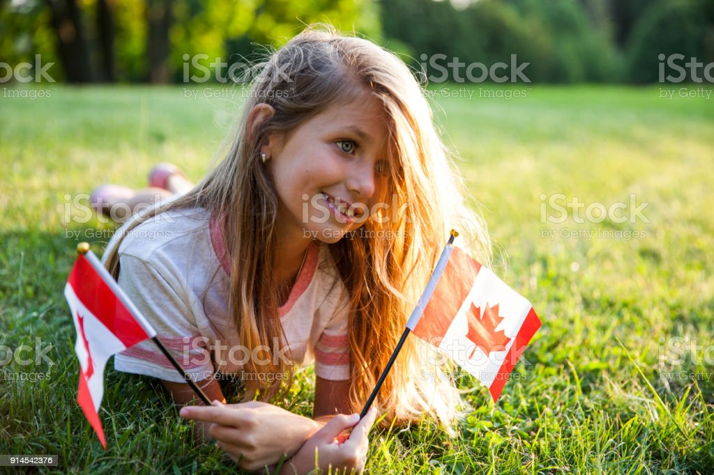 Canada Day - Patriotic Little Girl with the Canadian Flag stock photo
