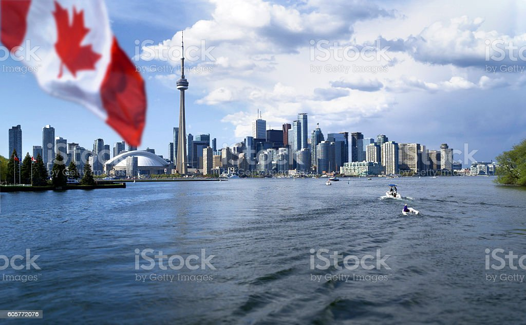 Canada flag is waving front of Toronto City stock photo