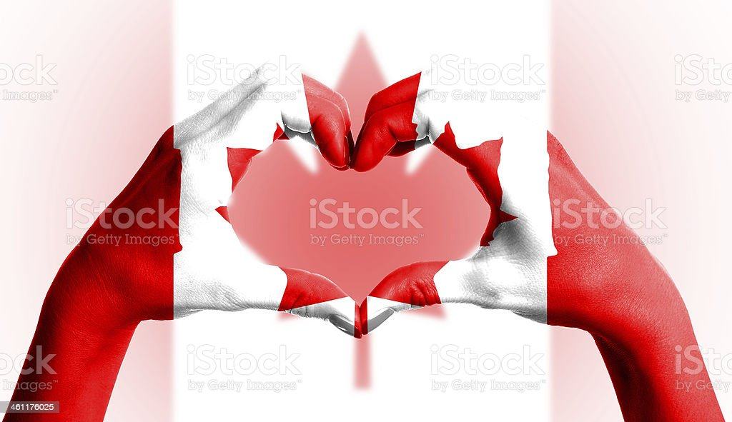 Canada flag over heart-shaped human hands on isolated background royalty-free stock photo