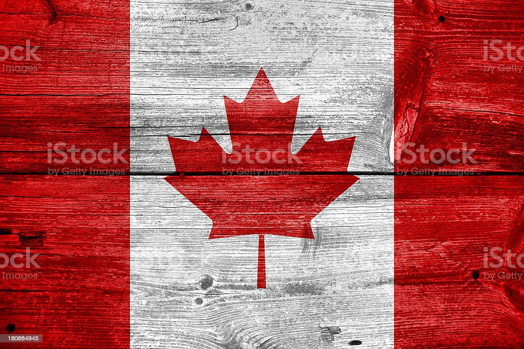 Canada flag painted on old wood plank background royalty-free stock photo