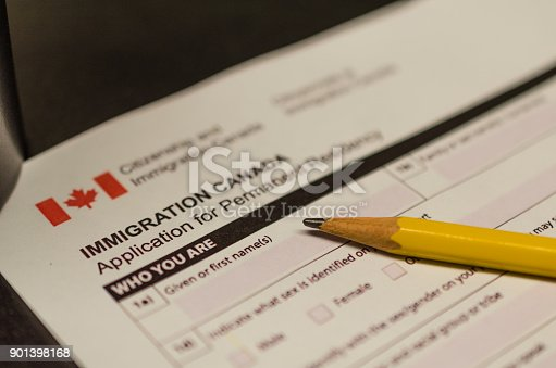A fake Canada immigration application form kept with pencil
