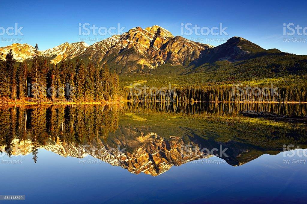 Canada Jasper National Park Pyramid Lake Sunrise Reflection stock photo