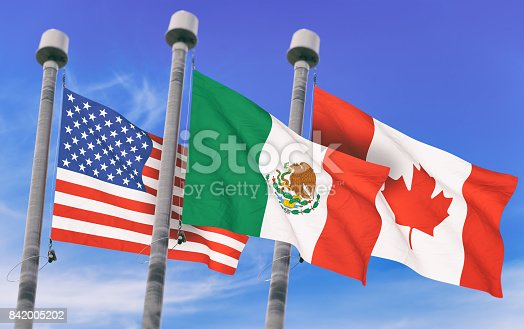 istock Canada, Mexico and US Flags over blue sky, conceptual image for Nafta agreement (3D rendered image) 842005202
